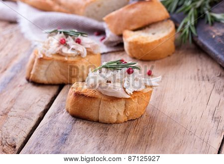 Traditional french dish rillette sort of pate. Toast bread with chicken pate on wooden desk. poster