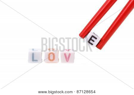 Love Written In Letter Beads With Chopsticks Holding E