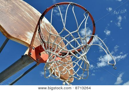 An outdoor basketball boop with a sky background poster
