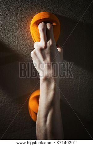 Cropped view of rock climber gripping handhold