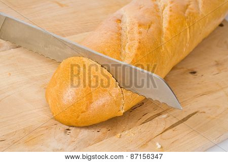 Knife cuts French baguette