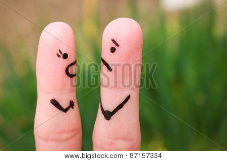 Finger art of a couple during quarrel. A woman yells at a man.