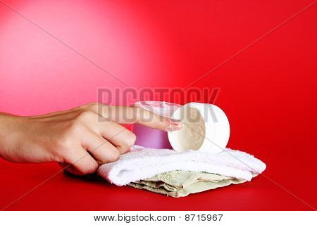 poster of Moisturizing cream and a woman hand on red background.