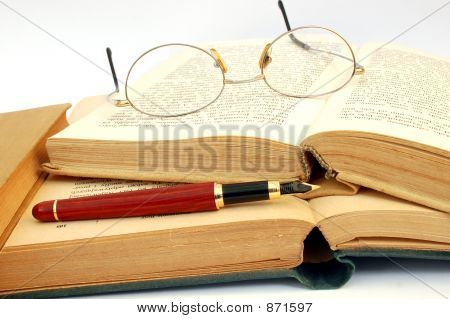 photo of vintage books glasses and fountain pen poster