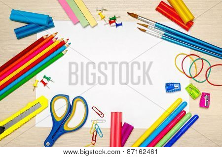School Supplies With Blank Paper On The School Desk