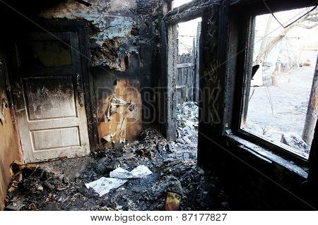 Conflagration. Burned room inside of the house