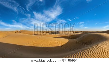 Panorama of dunes landscape with dramatic clouds in Thar Desert. Sam Sand dunes, Rajasthan, India