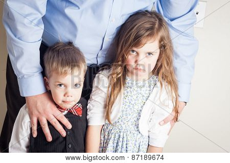 Portrait Of Brother And Sister Held By A Father