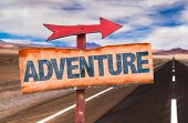Adventure sign with road background poster