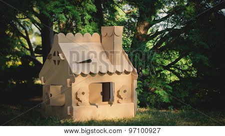 Toy house made of corrugated cardboard in the city park