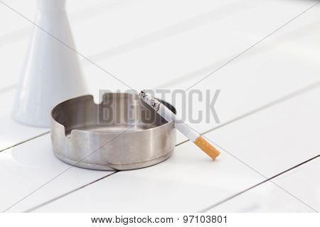 Cigarette In Ashtray On The Table