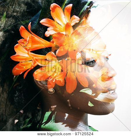 Double exposure portrait of beautiful african american woman combined with photograph of flowers