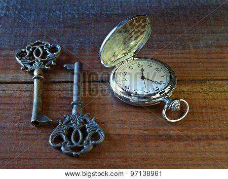 Pocket watch with two old keys