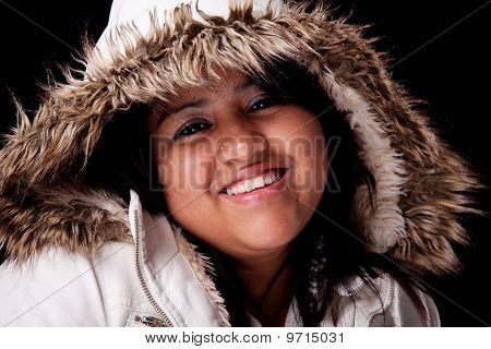 Portrait Of A Young Latin Woman With A Furry Hood , In Autumn/winter Clothes, Isolated On Black. Stu
