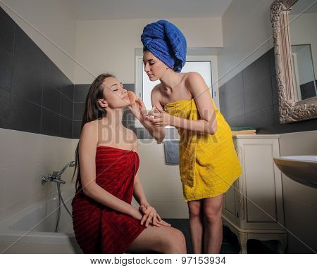 Two girls in the bathroom getting ready