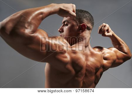 Male bodybuilder flexing his biceps poster