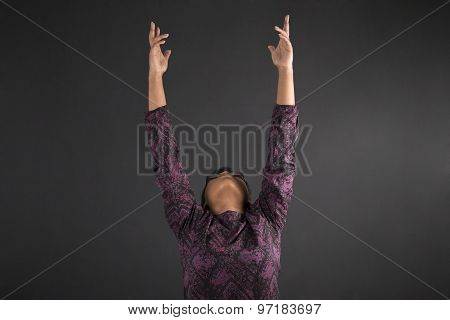 South African Or African American Woman Teacher Or Student Reaching For The Sky On Blackboard Backgr