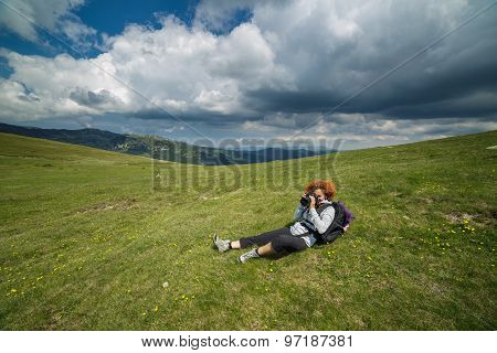 Woman Taking Pictures On Mountains