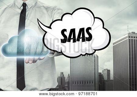 Saas text on cloud computing theme with businessman