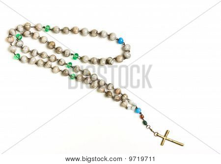 Rosary beads of decorated hazlenuts from low perspective isolated against white. poster