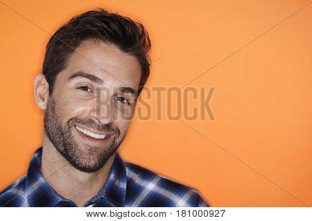 Happy guy with stubble smiling studio shot