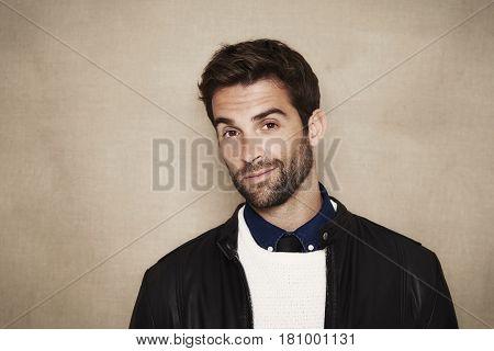 Smiling stubble guy in studio portrait studio