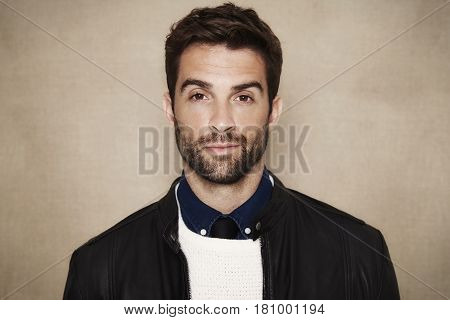 Man with stubble in studio portrait studio