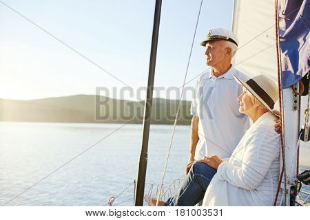 Retired woman and man having rest on yacht