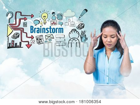 Digital composite of Woman with hands touching head and Brainstorm text with drawings graphics