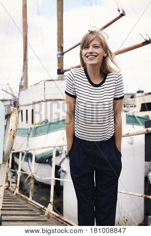 Portrait of beautiful woman in striped top smiling