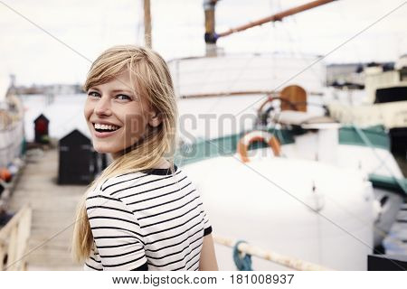 Striped top beautiful woman smilingat the docks