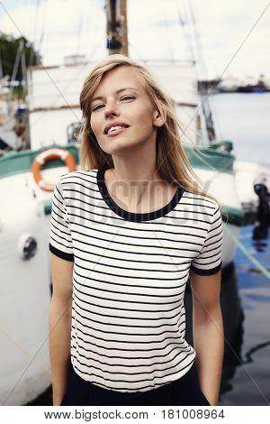 Gorgeous woman at harbor portrait outdoor shot