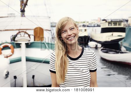 Beautiful sailor woman with toothy smile portrait