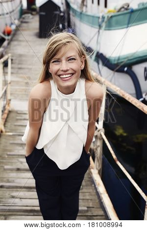 Gorgeous smiling sailor girl in boatyard portrait