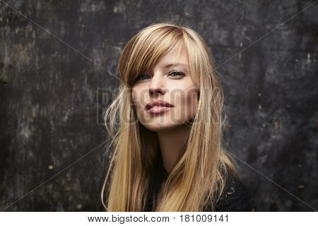 Gorgeous high fashion  blond woman looking at camera