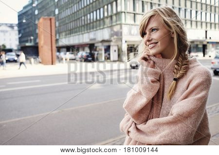 Beautiful woman in city looking away in the city