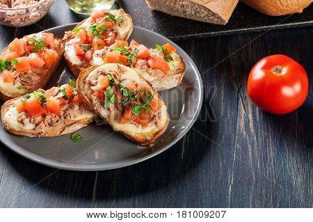 Appetizer Bruschetta With Tuna, Mozarella Cheese And Tomatoes