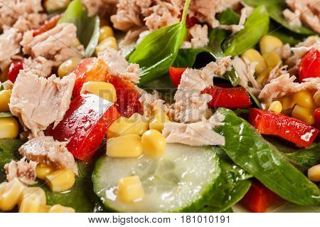 Fresh Spinach Salad With Tuna, Cucumber, Corn, And Red Paprika On A Plate
