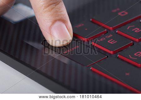Finger Pushing Enter Button On Laptop Keyboard