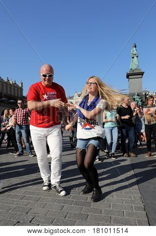CRACOW POLAND - APRIL 2 2016: International Flashmob Day of Rueda de Casino 57 countries 160 cities. Several hundred persons dance Hispanic rhythms on the Main Square in Cracow. Poland