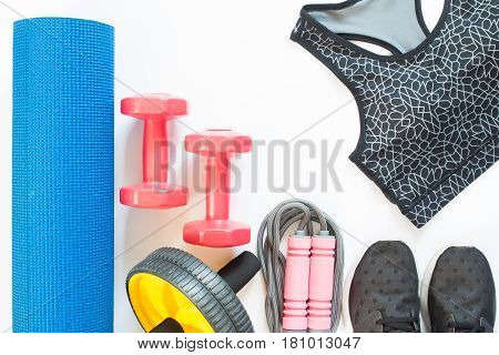 Flat lay of sport equipments with sport bra isolated on white background Healthy lifestyle concept