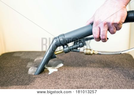 Cleaning couch with professional spray cleaner - detail