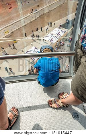 Overhead view boy looking down beach Brighton Tower. England.