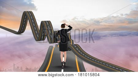 Digital composite of Digitally generated image of businesswoman on wavy road in sky