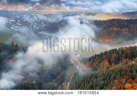 Slovakia forest autumn landscape with mountain with village