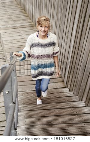 Portrait of smiling beautiful woman on steps