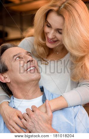 Beautiful Happy Mature Couple Hugging And Looking At Each Other