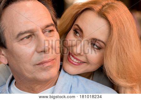Close-up Portrait Of Beautiful Happy Mature Couple Hugging