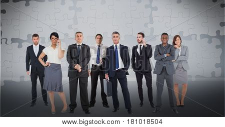 Digital composite of Digitally generated image of business people with puzzle pieces in background