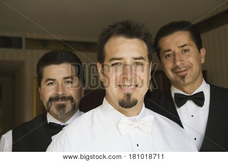 Portrait of Hispanic waiters